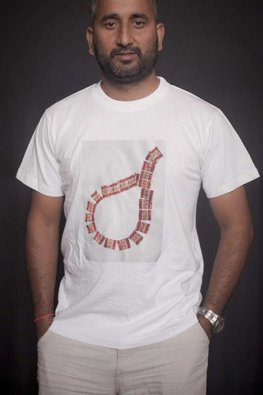 T-Shirt Gairimudi Artwork by: Collaborative work by Gairimudi-8 kids with Chocolate Rapper Available Colors- White, Black Available Size- S/M/L Price: RS. 800/- An artwork on the t-shirt is done by Shova Thapa from Gairimudi, Dolakha and the processed form the sale goes back to fund themselves.