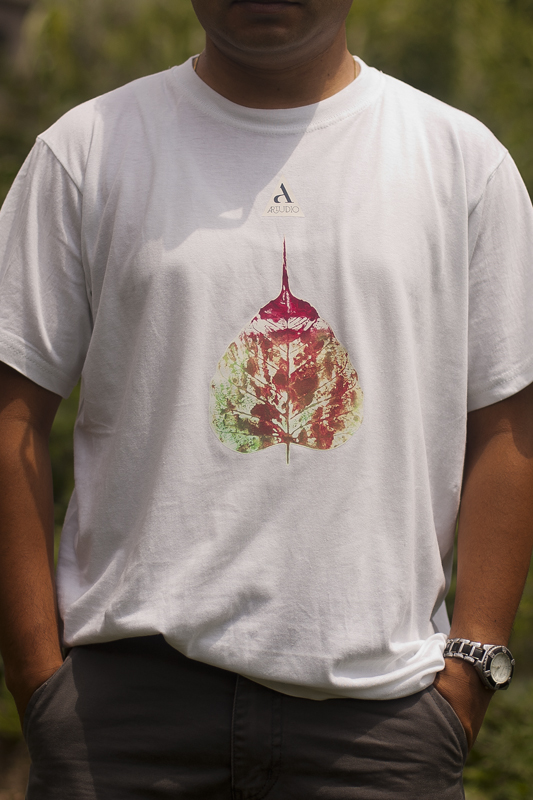 T-Shirt Gairimudi Artwork by: Shova Tapha- 13, Gairimudi-8 Available Colors- White, Black Available Size- S/M/L Price: RS. 800/- An artwork on the t-shirt is done by Shova Thapa from Gairimudi, Dolakha and the processed form the sale goes back to fund themselves.