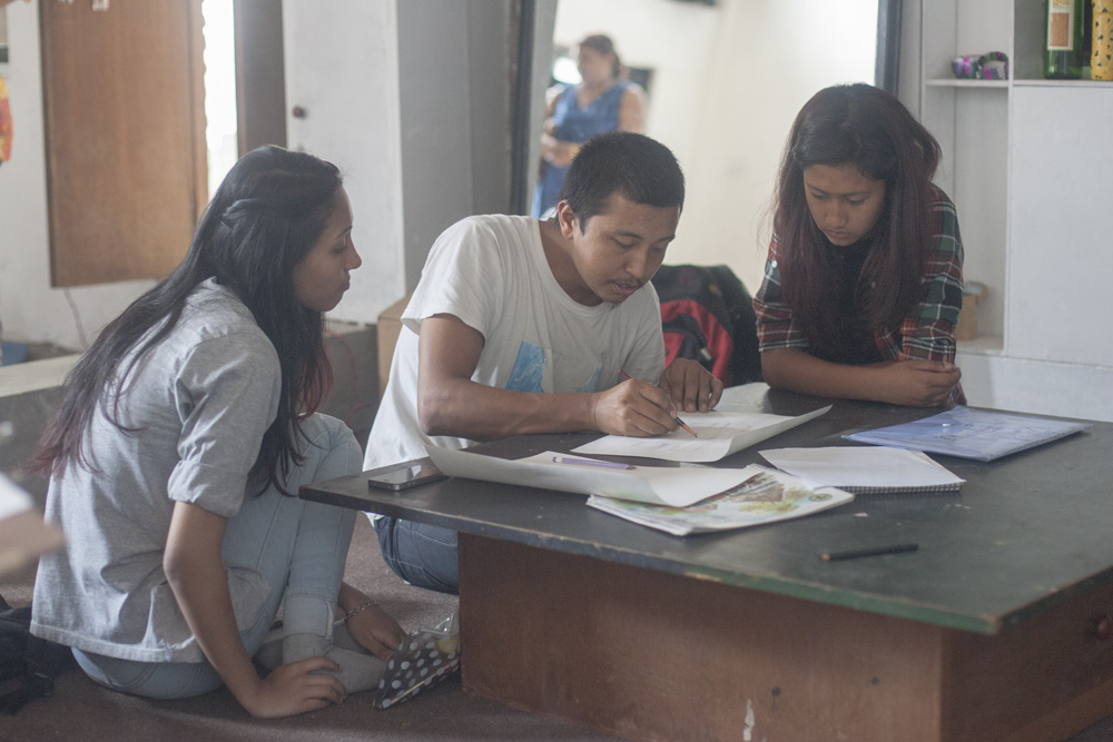 Artist Kailash K Shrestha mentoring the students on Art Saturday